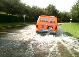 Water Damage Plantsville Van Driving Down Flooded Street